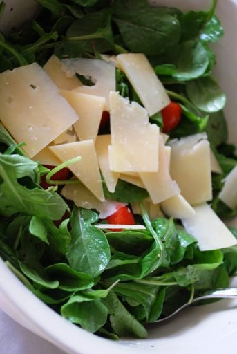 Arugula salad with lemon dijon dressing & cherry tomatoes.