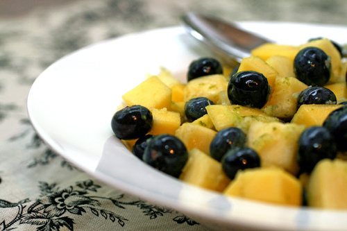 Simple fruit salad with ginger & agave nectar.