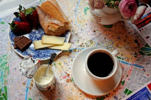 a parisian spread: chocolate, baguette, cheese, strawberries, coffee. yes, please